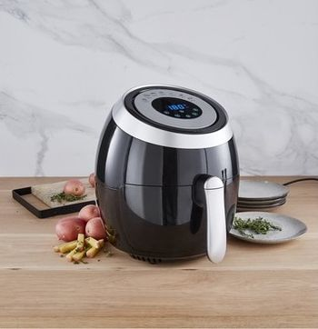 Kmart air fryer on kitchen bench with potatoes