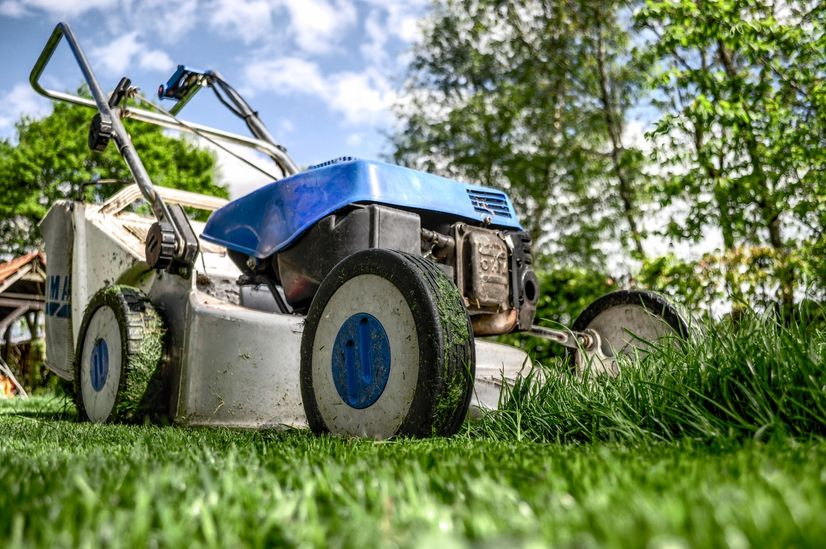A close up of a petrol lawn mower.