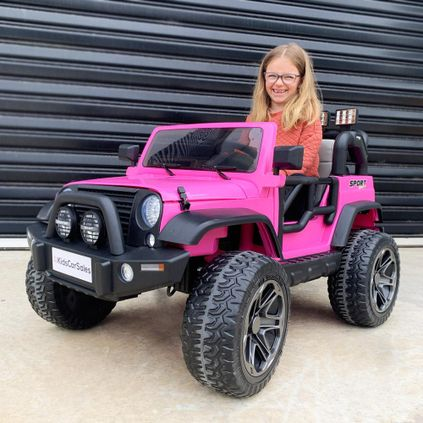 smiling girl in toy car
