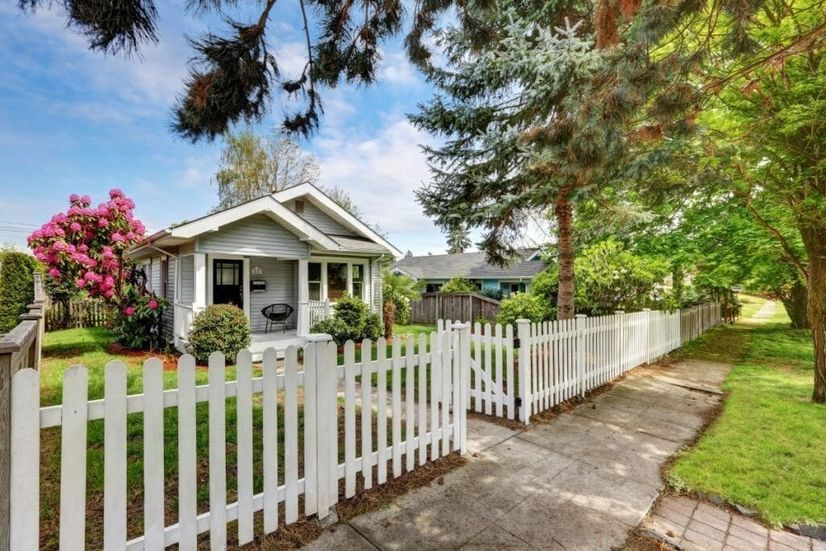 Image of house with a white picket fence