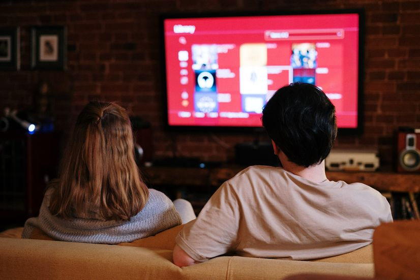 Couple watching a streaming service on TV