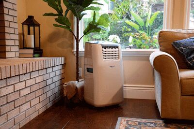 A portable air conditioner in the corner of a living room