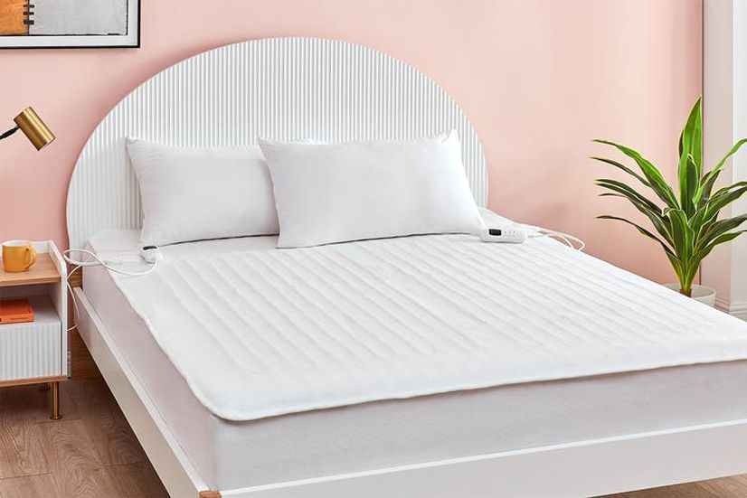 A fully fitted electric blanket on a queen bed