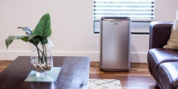 A portable air conditioner in a living room