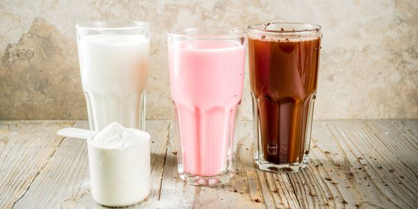 three flavoured weight loss shakes, vanilla, strawberry and chocolate with scoop of powder