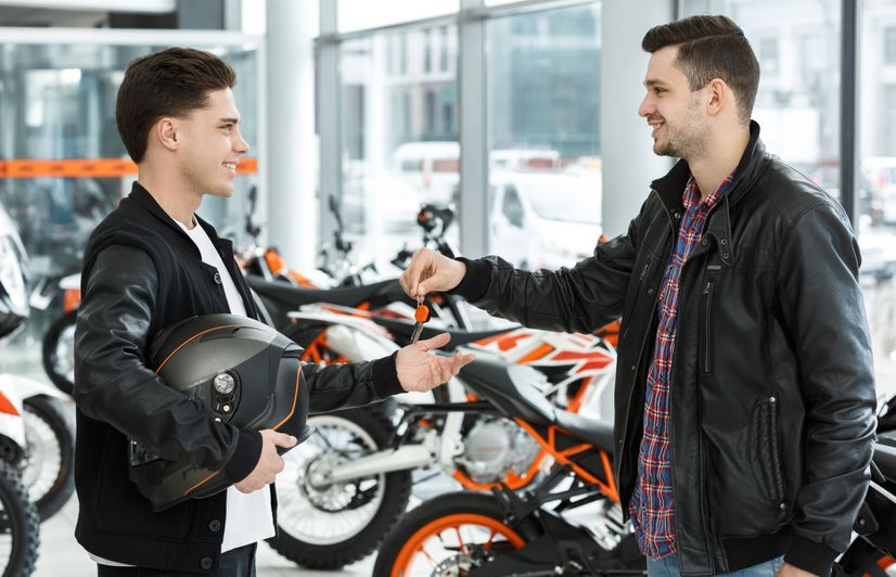 Learner rider getting the keys to a new motorcycle