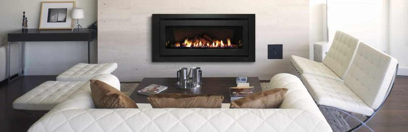 Gas log fireplace in living room