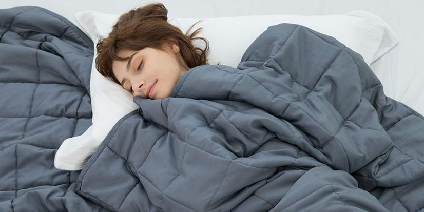 Girl sleeping under a weighted blanket